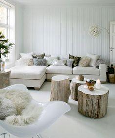 Traditional scandinavian living room interior. Love the tree stump tables.
