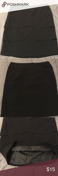 Black Ruffled Skirt Adorably slimming black ruffles skirt! Great for dressing up or wearing to the office with a tucked in blouse. Would look awesome with black pumps! Never worn but has been hanging in closet. Great condition! AB Studio Skirts Midi