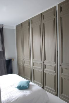 built-in closet with  paneled doors