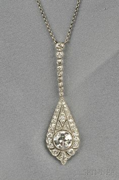 Art Deco Platinum and Diamond Pendant, bezel-set with an old European-cut diamond weighing approx. 1.20 cts., and old European and old single-cut diamond melee, millegrain accents, and suspended from delicate chain, lg. 1 3/4 in.