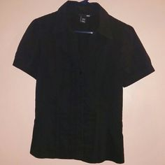 Black button down shirt H&M size 10 black button down short sleeve shirt. Lightly worn. Button on sleeves. H&M Tops Button Down Shirts