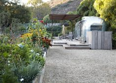 Grey's Anatomy star Patrick Dempsey converted an Airstream into extra living space at the edge of his kitchen garden in Malibu. / The Green Life Airstream Living, Airstream Remodel, Airstream Renovation, Airstream Trailers, Travel Trailers, Patrick Dempsey, Grey's Anatomy, Pergola, Tin House