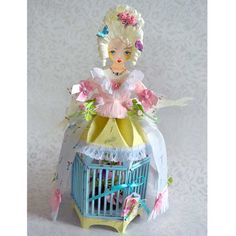 OMFG! a paper doll AND a bird cage!