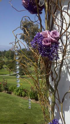Wedding ceremony arch decoration with curly willows, crystals and bouquets with all tones of purple.    Taken at Canyon Crest Country Club 04/07/12