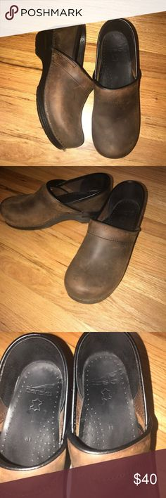 Dansko Clogs Size 41 Beautiful shoes in terrific condition.  Purchased on here, received, fell in love, and realized I purchased the wrong size.  Never worn by me, asking what I paid for them. Dansko Shoes Mules & Clogs