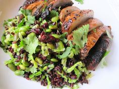 simple, scrumptious black rice salad, full of edamame, cabbage, and sesame-soy dressing, crowned with white miso-charred Portobello mushrooms.
