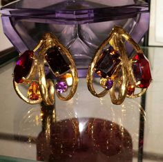 Daniel Swarovski Paris Couture Line 1989 Gold Tone Runway Clip On Earrings Ruby Topaz Amethyst Smoky Quartz by ArtsyMysticDesigns on Etsy Smoky Quartz, Clip On Earrings, Topaz, Amethyst, Swarovski, Paris, Couture, Gold, Runway