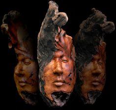 "''ENTRANCED'' mask carving by Nancy Tuttle out of  Bay Laurel  18 "" x 7"""