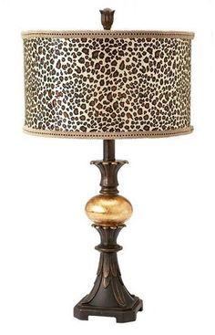 A leopard print lamp shade brings some drama to this bronze table lamp from Midwest CBK Home. Animal Print Furniture, Animal Print Decor, Animal Prints, Leopard Prints, Cheetah Print, Leopard Decor, Safari Home Decor, Safari Room, British Colonial Decor