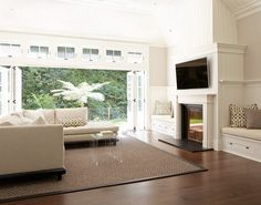 Living room that opens to outside for freash ait and light - traditional - living room - san francisco - Rasmussen Construction