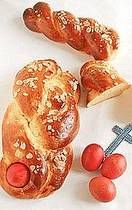 Serbian Easter Bread - This sweet braided egg bread as hard-cooked eggs that have been dyed red are nestled atop the braid. The red color symbolizes the blood Christ shed and the eggs are a universal symbol of Christ's resurrection.