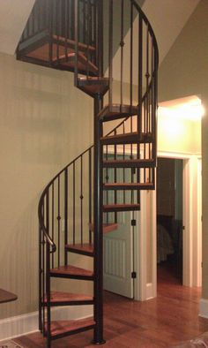 At this Lake Lanier home, a metal spiral stairway, with white oak treads, was part of a new addition to a loft.