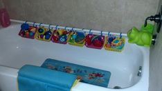 Bath Toy Storage DIY $5 -- 15 minutes.  Bought shower curtain rod, rings and basket (3/$1) at dollar store.  Quick and simple install.  Hung rod just above the tub so the baskets hang at an angle for good drainage.  Not only serves as nice storage for bath toys but also helps teach my twin toddlers put their toys away when we are done.