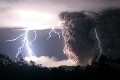 Green lightning strikes as the Chaiten volcano erupts during storms in the middle of the night on May 3, 2008 in Chile.