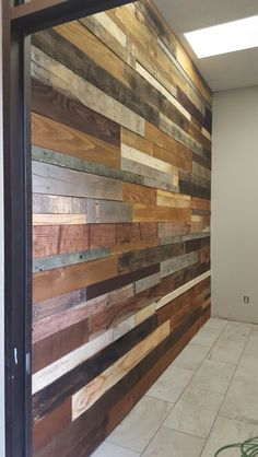 Wood pallet wall .  Made from fence boards and pallets from lowes, then stain and vinger, then nail gun. 3 days work.