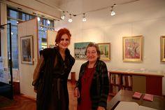 The RedHead (Rossana Diana) walks around Brera during Brerarte, the week of art in Milan. Here with Ferdinanda Consonni.