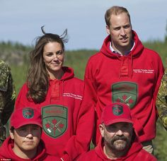 William and Kate pose wearing the sweaters of the Canadian Rangers after being made honorary members during a visit to Blatchford Lake, Northwest Territories July 5