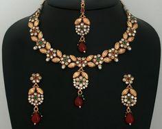 Bridal fashion Gold plated clear and Ruby,Emerald stones Polki set -11PLK16  http://www.craftandjewel.com/servlet/the-1694/Bridal-fashion-handmade-jewelry/Detail