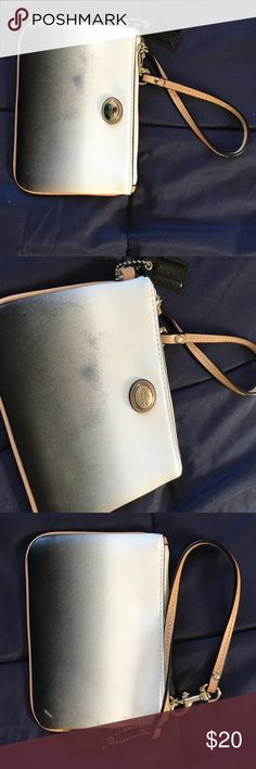 """Coach ombré wristlet VGUC authentic Coach wristlet. Used once. White, gray, black ombré color. Black interior. Smoke free home.  Saffiano leather  Inside multifunction pocket  Zip-top closure, fabric lining  Strap with clip to form a wrist strap or attach to the inside of a bag  6 1/4"""" (L) x 4 1/4"""" (H)  This is a signature product Coach Bags Clutches & Wristlets"""