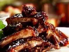 """Country Style Ribs With Hoisin Sauce..    """"Hoisin sauce is a rich, reddish brown sauce with a sweet and spicy flavor. It's also called Peking sauce. It's a mixture of soybeans, garlic, chilies, and spices. You can find hoisin sauce in the Asian foods section of your local supermarket.  Here is one of the best recipes for pork ribs that you'll ever eat. They are so delicious. """""""