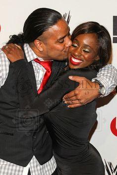 Jonathan Fatu {son of WWE wrestler Rikishi} kissing his fiancee Trinity McCray at a WWE event
