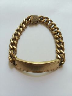 """PLEASE VIEW PHOTOS CLOSELY, they are part of the description!  Vtg Elco ID Bracelet. Marked """"1/20 12K G.F.""""  ***Stamped """"EW"""" very faintly, could possibly stamp over.***  Shows wear throughout bracelet, especially on closure where some gold has worn off.  Approx 8.5"""" laid flat on ruler, closer to 9"""" when you account for the curve on the back of the ID section. Weight is approx 60g.  This will be carefully packaged and promptly shipped.  Inv:bb2xpemd"""