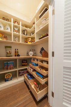 Kitchen pantry - The walk-in pantry with built-ins maximizes storage space.