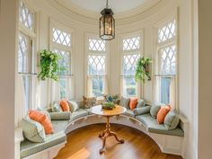 Plush and graceful, this window seat alcove just needs a good book and a warm cup of tea. #DreamHome #windowseat #nook