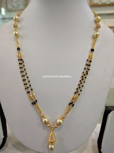 Black beads short necklace sets for churidars, western wear and sarees. 22 carat gold necklaces with south sea pearls emerald beads co. Gold Mangalsutra Designs, Gold Earrings Designs, Gold Jewellery Design, Necklace Designs, Bridal Jewelry, Beaded Jewelry, Pearl Jewelry, Indian Jewelry, Gold Jewelry Simple