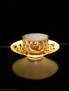 Eggshell porcelain cup and saucer with design of phoenix by Hirado Tousyo