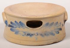 "Sold $ 350 Cowden & Wilcox (Harrisburg, PA) Large Stoneware Spittoon. Circa. 1860-1887. Cobalt blue brushed slip design. Concave top and body, ear handles and molded base rim. 4 3/4""h x 10 1/2"" diam. Condition: Good with a hairline and crude chip repair under base."