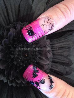 Pink freehand nail art with spider and bat Halloween nail art