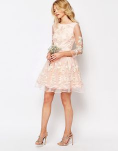 Image 4 ofChi-Chi London Petite Premium Allover Floral Embroidered Mini Prom Dress With Mesh Sleeve
