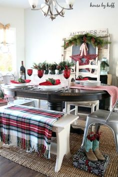 A giant red star watches over a vibrant dining table in blogger April's Christmas home.