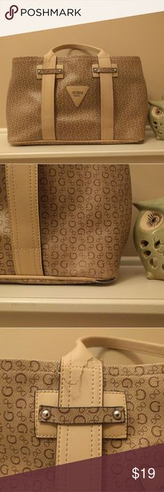 NEW Listing! Guess purse cream and tan VERY clean pretty, chic purse from Guess. Retailed $79. Has two small flaws in pics: some of the stitching needs to be resewn on one strap. Also small part of bottom piping has mild wear. Overall canvas parts are great and clean! Make an offer! Guess Bags