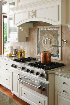 Kitchen of Monica Hart : La Famiglia blog,  Photo by John Granen : Rangetop and backsplash