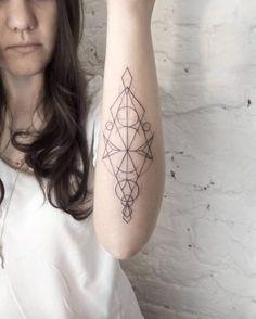 Geometric Forearm Tattoo by Dasha Sumkina
