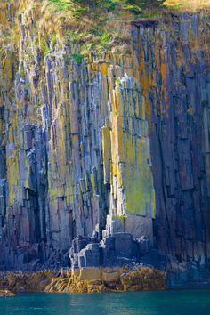 Colorful volcanic rocks on the shore of Briar's Island, Nova Scotia - Canada