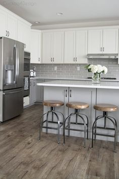 My friends gorgeous gray and white kitchen - vinyl plank flooring and wood and metal counter stools in grey and white kitchen - Grey Kitchen Floor, Gray And White Kitchen, Floors Kitchen, Vinyl Flooring Kitchen, White Grey Kitchens, Kitchen Curtains, White Kitchen Designs, Vinyl Sheet Flooring, Vinyl Planks