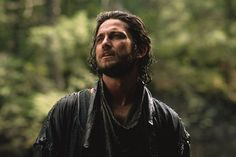 Gerard Butler in Timeline:  Rockin the long curly hair and beard.