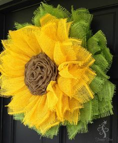 sunflower-wreath-ribbon-center-sprayed-doorxx We've updated our sunflower wreath using a stacked wreath method and added a burlap ribbon rose for the center. Using the stacked wreath method results in Burlap Crafts, Wreath Crafts, Diy Wreath, Tulle Wreath, Ribbon Crafts, Wreath Ideas, Deco Mesh Wreaths, Holiday Wreaths, Holiday Decorations