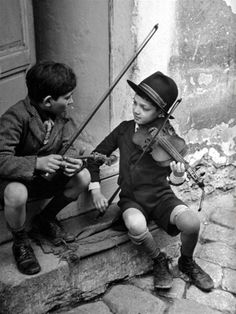 Romanian children playing the violin.