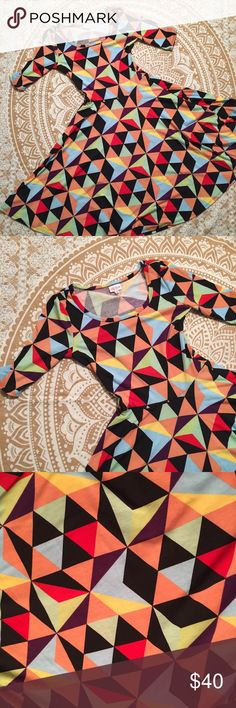 Lularoe Nicole Bright Colored Block Pattern Love, love, love Lularoe!! The Nicole dress is absolutely flattering on everyone, totally versatile, and simply comfortable. I love this bold, bright pattern and all those colors!! I'm only selling because I majorly need to downgrade my Lularoe collection, haha. I only wore this one twice so it's in great condition! This looks super cute with knee-high black socks! LuLaRoe Dresses