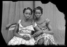 Seydou Keïta's untitled photograph of two women in Bamako, Mali circa 1952/1955.