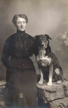 Vintage Photo:  A woman in mourning posing with her beloved & devoted dog.