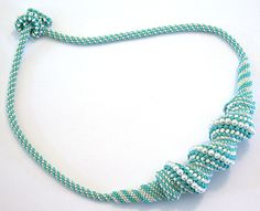 Peyote with twist: blue seed beads & tiny real pearls.