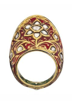 A DIAMOND-SET AND ENAMELLED GOLD ARCHERY RING   INDIA, PROBABLY 19TH CENTURY.   Of typical form with a slightly pointed back, the exterior with floral sprays on red ground, the petals and leaves set with diamonds, the interior with white and black flowers linked by gold stems on green ground, some flaking around the edges  1 5/8in. (4.2cm.) long