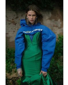 Pairing a hoodie with an evening dress is such a great street style outfit. Especially with sneakers or to attend fashion week. Weird Fashion, Fashion Wear, Look Fashion, High Fashion, Fashion Outfits, Womens Fashion, Fashion Details, Fashion Design, Margiela