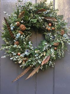Luxury Christmas wreath incorporating pheasant feathers - Home Decor Homemade Christmas Wreaths, Christmas Door Wreaths, Noel Christmas, Green Christmas, Holiday Wreaths, Rustic Christmas, Christmas Crafts, Christmas Flower Arrangements, Christmas Flowers