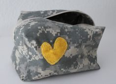 Want!   makeup / toiletry bag -- US Army - ACU camouflage material. $20.00, via Etsy.